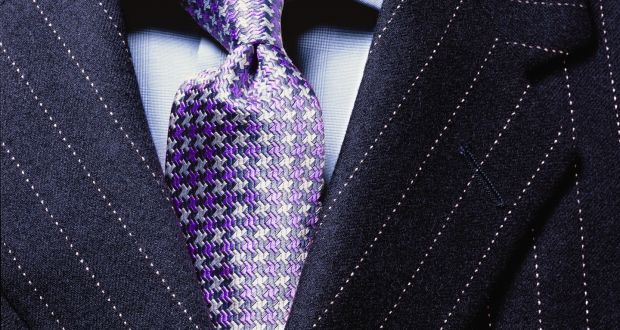 Will the suit and tie become a thing of the past? Some  companies are relaxing their dress code. Photograph: Getty Images