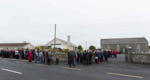 Crowds queueing to pay their respects at the removal of Caitríona Lucas at Liscannor, Co Clare, on Wednesday. Photograph: Eamon Ward