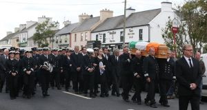 Mourners at the  funeral for Coast Guard volunteer Caitríona Lucas takes place at St Brigid's Church in Liscannor, Co Clare. Photograph: PA