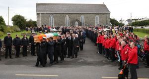 A guard of honour is seen at the funeral for Coast Guard volunteer Caitríona Lucas takes place at St Brigid's Church in Liscannor, Co Clare. Photograph: PA
