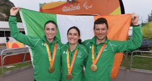 Eve McCrystal, Katie-George Dunlevy and Eoghan Clifford  with their medals at the the Rio  Paralympic Games. Photograph: Diarmuid Greene/Sportsfile