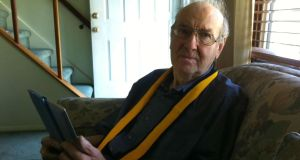 Noreen Bowden's father listening to the All-Ireland final on her iPad in 2012.