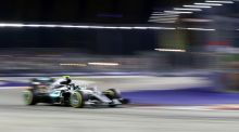 Mercedes driver Nico Rosberg of Germany steers his car during the Singapore Formula One Grand Prix on the Marina Bay City Circuit in Singapore. Photo: AP