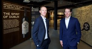 "Jack Teeling (left), who founded the company, pictured with his brother Stephen,  said visitor numbers were ""significantly ahead"" of its projections. Photograph: Patrick Bolger"