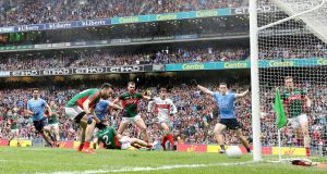 Dublin and Mayo players look on as Kevin McLoughlin scores an own goal at Croke Park. Photograph: Cathal Noonan/Inpho