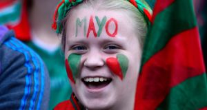 I love Mayo: A fan in green and red  during the All-Ireland football final between Dublin and Mayo at Croke Park. Photograph: Cyril Byrne/The Irish Times