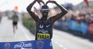 Mo Farah celebrates winning The Great North Run earlier this month. Photograph: Nigel Roddis/Getty Images for Nike