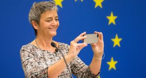 EU commissioner Margrethe Vestager uses an Apple iPhone to take a picture in  Washington DC on Monday. Photograph:  EPA