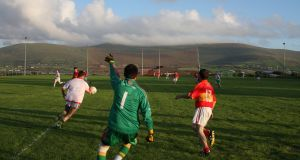 Sneem take on Valentia on the island's GAA pitch. Valentia has had to merge with Portmagee, Derrynane and Sneem – some 30km away – to field an underage team. Photograph by Paul Carroll, from his book 'Gaelic Fields'