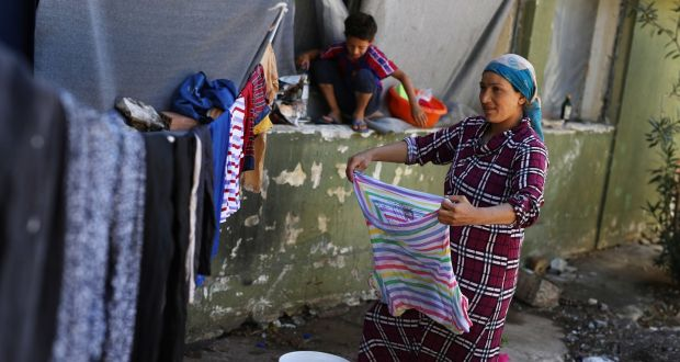 A Syrian Kurdish woman hangs out washing at Ritsona refugee camp north of Athens, which hosts about 600 refugees and migrants. The EU's border agency says the number of migrants arriving in the Greek islands has increased significantly over the past month. Photograph: Petros Giannakouris/AP