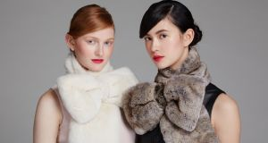 Lebue fur bow scarves in cream and natural, €400. Tivoli leather dress in black €1,065. Photograph: Miki Barlok