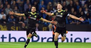 Chelsea's Spanish midfielder Cesc Fabregas celebrates scoring their fourth goal with teammate Gary Cahill. Photograph: Getty Images