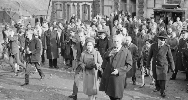 Queen Elizabeth II and Prince Philip visit Aberfan in Wales to comfort the families of the