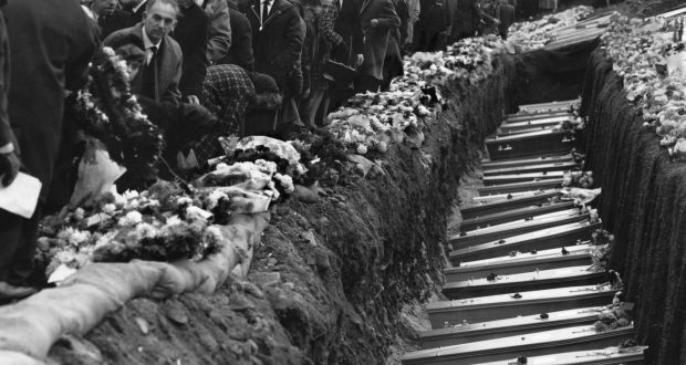 Inhabitants of the Welsh mining village of Aberfan attend the mass funeral for 81 of the
