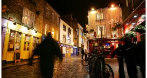 Temple Bar at night. Photograph: Bryan O'Brien