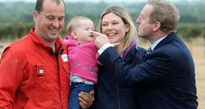 On the nose: Taoiseach Enda Kenny with ploughing champion Brian Mahon, Michelle Mahon and their baby daughter Chloe, from  Blueball, Co Offaly, at the National Ploughing Championships at Screggan, Co Offaly. Photograph: Eric Luke