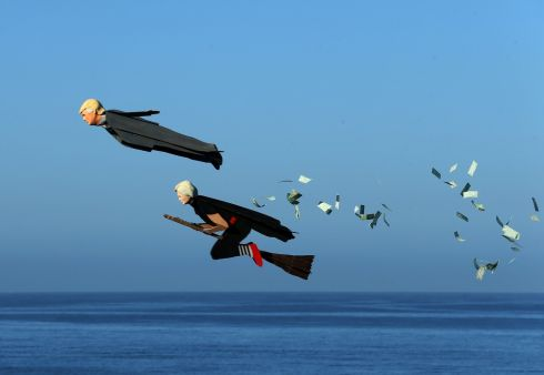 Model plane builder Otto Dieffenbach III makes his remote control plane resembling U.S. Presidential candidate Donald Trump release fake money as it flies over the beach next to a similar plane resembling Hillary Clinton in Carlsbad, California, U.S. September 15th.  Photograph: Mike Blake / Reuters