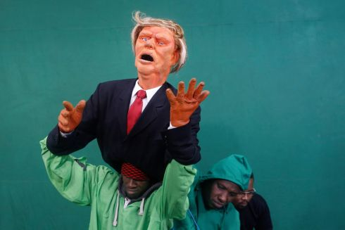 Puppeteers control the Donald Trump puppet during the shooting of the 11th season of 'The XYZ Show' satirical puppet show at a studio in Nairobi, Kenya, 30th August.  Photograph: Dai Kurowawa / EPA