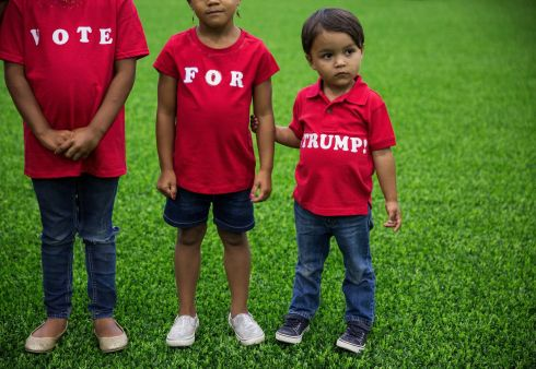Violet Payne, 6, Autumn Payne, 5, and Onyx Payne, 3, wear homemade shirts supporting Donald Trump,  during a campaign event at the Grand Park Events Center in Westfield, Ind., July 12th. Photograph: Damon Winter/The New York Times