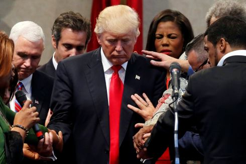 Members of the clergy lay hands and pray over Republican presidential nominee Donald Trump at the New Spirit Revival Center in Cleveland Heights, Ohio, U.S., September 21st.  Photograph: Jonathan Ernst / Reuters