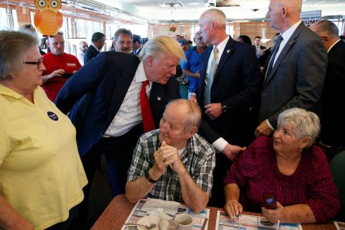 Republican presidential candidate Donald Trump meets with patrons during a visit to the Boulevard Diner, Monday, Sept. 12th in Dundalk, Md. Photograph: Evan Vucci / AP