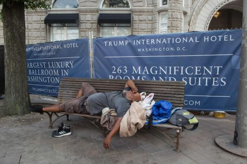 A homeless man sleeps on a bench in front of the construction site of the Trump International Hotel in Washington, DC, on September 8th.  Photograph: Nicholas Kamm / AFP