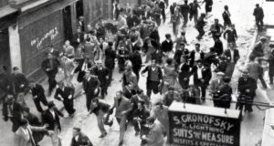 Anti-fascist protesters, some of them carrying missiles, run from a barricade they have erected near Aldgate on October 4th, 1936. The police are charging on the far side of the barricade, which has been reinforced with paving stones. Photograph: Jewish Chronicle/Heritage Images/Getty Images