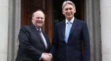 Minister for Finance Michael Noonan and   Britain's chancellor of the exchequer Philip Hammond  at the Treasury office in London. Photograph:   Reuters