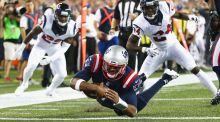 New England Patriots quarterback  Jacoby Brissett dives for a touchdown during the first quarter against the Houston Texans at Gillette Stadium in Foxboro, Massachusetts. Photograph: Adam Glanzman/Getty Images