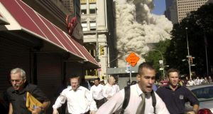 People run from the collapse of World Trade Center Tower on September 11th, 2001, in New York. Photograph: Suzanne Plunkett