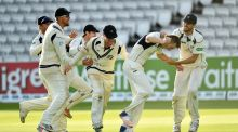 Toby Roland-Jones of Middlesex is mobbed by his team mates after taking the final wicket of Ryan Sidebottom of Yorkshire to win the match and the County Championship at Lords. Photograph: Dan Mullan/Getty Images