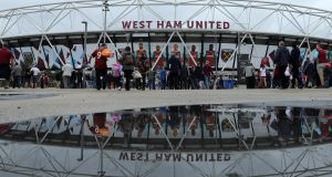 "Supporters walk to the London Stadium ahead of West Ham United's home match against Watford, which they lost 4-2. As Billy Bonds said this week, whatever the London Stadium is, ""it isn't a football ground"". Photograph: Richard Heathcote/Getty Images"