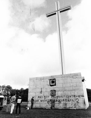 "1980: Slogans daubed on the Papal Cross in the Phoenix Park, Dublin The slogan reads: ""If men got pregnant contraception and abortion would be sacraments.""  Photograph: Pat Langan"