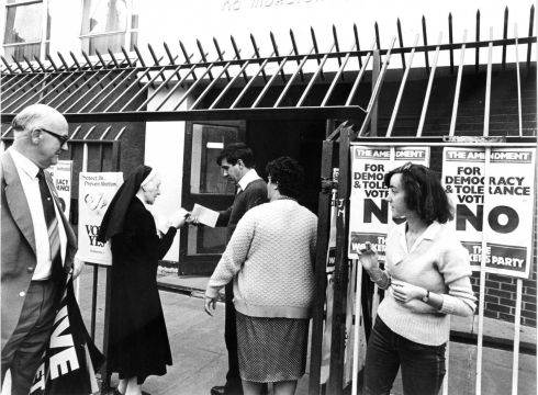 1983: A nun hands out leaflets at Basin Lane, Dublin on abortion referendum day.  Photograph: Pat Langan/The Irish Times