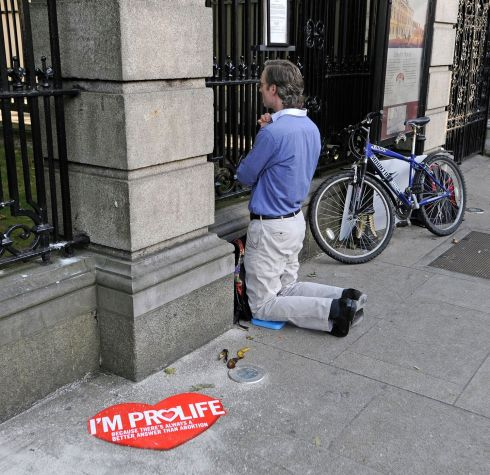 2013: An anti-abortion protestor prays outside the Dail as the amendments to the Protection of Life During Pregnancy Bill are debated. Photograph: Dave Meehan