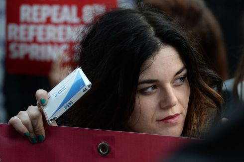 2014: Emma Quinn, from Blanchardstown with a box of pills after joining pro-choice activists who returned by  train to Connolly Station Dublin from Belfast and brought back safe, non-surgical abortion pills banned in the Republic. Photograph: Dara Mac Donaill/The Irish Times