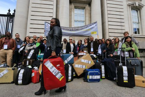 2015: International delegates, at an international gathering which took place in Dublin outside the Department of the Taoiseach, with numerous suitcases to signify women obliged to travel to the UK for a safe and legal abortion. Pictured is Maureen Gombakomba.  Photograph: Nick Bradshaw