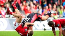 Munster centre Cian Bohane ensures Edinburgh's Damien Hoyland is going nowhere at Thomond Park on Saturday afternoon. Photograph: Tommy Dickson/Inpho