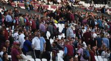 Fans leave their seats before full time at London Stadium. Photograph: Mike Hewitt/Getty Images