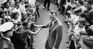 "A grinning Arnold Palmer surrounded by applauding citizens of his native Latrobe, Pa, shaking hands with a couple of enthusiastic boys in April 1960. Palmer, known for making golf popular for the masses with his hard-charging style, incomparable charisma and a personal touch that made him known throughout the golf world as ""The King,"" died on Sunday, September 25th, 2016, in Pittsburgh. He was 87.  Photograph: AP Photo/File"