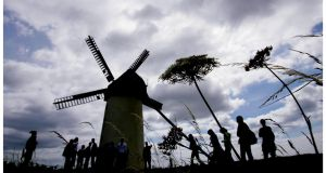 Tourists at the   Great Windmill of Skerries in North County Dublin. The town has been named as the overall Tidy Towns winner for 2016.  Photograph: Bryan O'Brien/The Irish Times