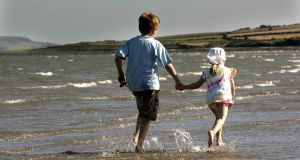 Children enjoy Skerries beach, which has been named as this year's Tidy Towns winner.   Photographer: Dara Mac Dónaill