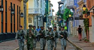 Colombian soldiers patrol a street in Cartagena prior to the signing ceremony on Monday of a peace deal between the Colombian government and Farc. Photograph: Ricardo Maldonado Rozo/EPA
