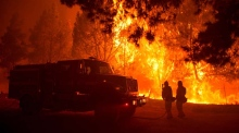 California brush fire threatens homes