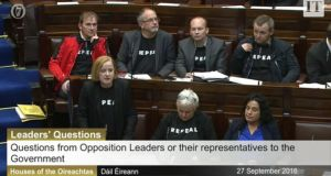 AAA-PBP TDs wear Repeal shirts in the Dáil.