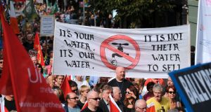 Protesters at an anti-water charges march in Dublin. Fianna Fáil spokesman Barry Cowen denied the party had been inconsistent on the issue. Photograph: Caroline Quinn/PA Wire
