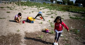 Children play with toys yesterday at a makeshift refugee and migrant camp close to the border between Serbia and Hungary. Photograph: Getty Images