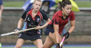 Monkstown's Anna O'Flanagan (right) has scored nine goals in two games. Photograph: Rowland White/Inpho/Presseye/