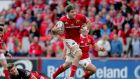 Munster's Dave O'Callaghan evades Edinburgh's Michael Allen. Photograph: Morgan Treacy/Inpho