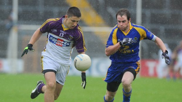 Ronan Brady (left) in action with Roscommon. Photograph: Matt Browne